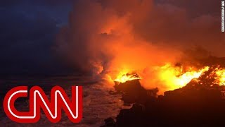 Download See lava from Hawaii volcano reach the ocean Video