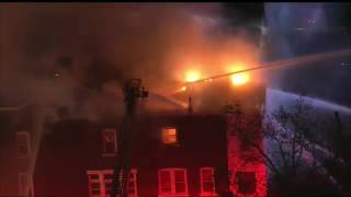 Download Firefighters are working to contain a multiple home fire in Allentown, Pennsylvania Video
