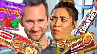 Download AMERICANS TRY INDIAN SNACKS Video
