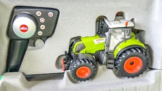 Download RC tractor gets unboxed and works hard for the first time! Video