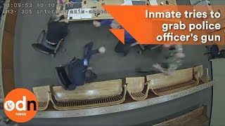 Download Shocking footage of Inmate trying to grab police officer's GUN inside courtroom Video