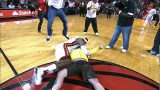 Download LeBron tackles Heat fan who hits $75,000 shot! Video