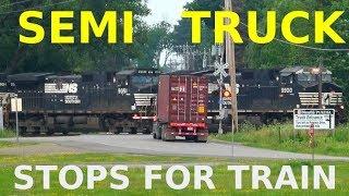 Download Semi Truck Stops For Train at Railroad Crossing Video