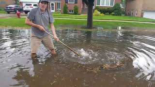 Download Draining a Flooded Street Video