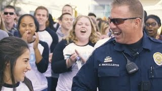Download Massive mob overwhelms school's favorite police officer! Video