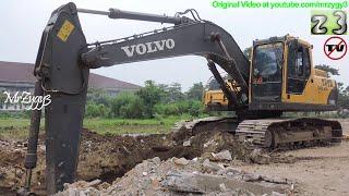 Download Volvo Excavator EC210B Digging Loading Dump Truck Video