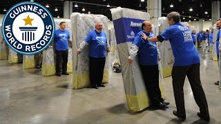 Download Largest human mattress dominoes - Guinness World Records Video