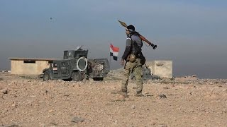 Download Iraq forces press assault on IS south of Mosul Video
