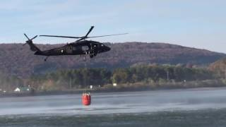 Download Blackhawk helicopter pulls water from lake to fight wildfires Video