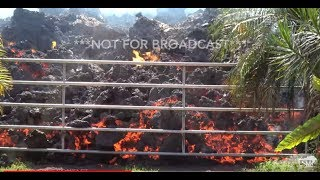 Download 5-5-2018 Leilani Estates - Hawaii Volcano - Lava Flows Busts Gate - Overtakes Homes and Vehicles Video