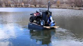 Download ATV floats on small boat Video