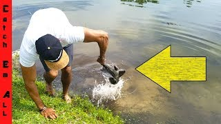 Download FISH MAKES PEOPLE PUKE when CAUGHT BY HAND! Video