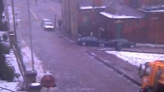 Download Car slides down icy street hitting owner and 3 other cars in Rochdale Video