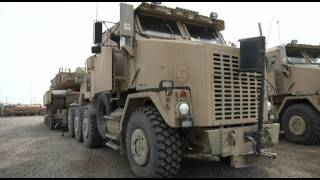Download M1 Abrams Tanks being loaded into trucks for shipment out of Base ADDER, IRAQ Video