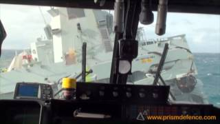 Download Lynx performing impressive landing on ship in rough weather Video