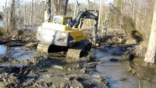 Download Excavator Busting a Huge Beaver Dam Video