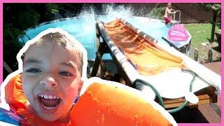 Download 😂HUGE SLIP-N-SLIDE OFF ROOF INTO SWIMMING POOL! Video