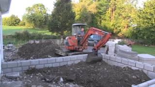 Download Hitachi Mini Digger prepares a Foundation Video