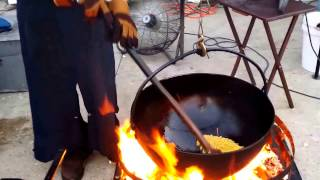 Download Amish man and wife making kettle cooked popcorn. Video