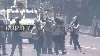 Download Venezuela: Tear gas flies in Caracas as death toll during anti-govt. protests rises Video