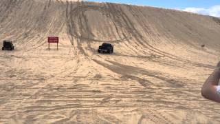 Download 1000HP Lifted Cummins on Paddle Tires at Silver Lake Sand Dunes Climbing Test Hill Video