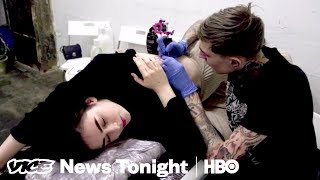 Download How Russian Prisoners Are Using Tattoos To Protest Putin (HBO) Video