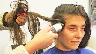 Download Hair clipper running her long hair to shave both sides of her head Video