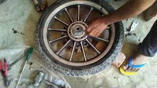 Download royal enfield classic front wheel bearing change video hindi me Video