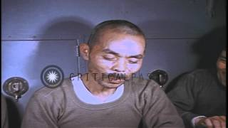 Download Japanese prisoners seated at a table eating food aboard USS Skate underway in the...HD Stock Footage Video