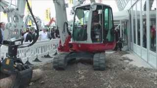 Download Takehuchi excavator with amazing attachments Video
