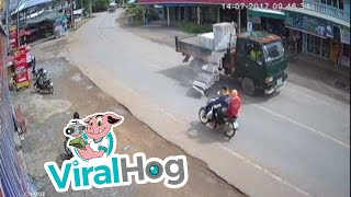 Download Lucky Motorcyclists Escape Bricks Falling from Truck Video