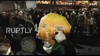 Download UK: Trump effigy beaten to pulp as protest against new US president rocks London Video