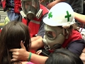 Download 'Green Helmets' Give Aid to Venezuela Protesters Video