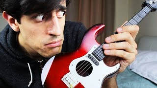 Download TOY BASS GUITAR SOLO Video