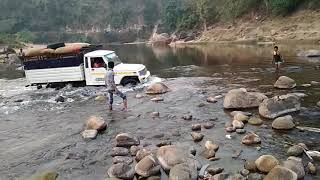 Download Mahindra bolero pick up fully loaded through rocky river|Stuck in the middle !! but comes out !! Video
