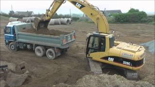Download CAT 320C Excavator loading trucks Video