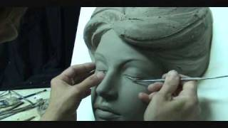 Download Sculpting a face in clay. Sculpting demo how to sculpt girl's face. Video