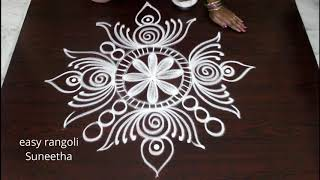 Download Bright n cute rangoli arts designs by Suneetha  easy n simple kolam with out dots    daily muggulu Video