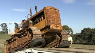 Download Unloading 1948 6 cylinder Cletrac crawler at new home. Video