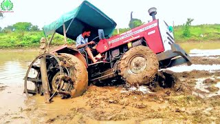 Download Massey Ferguson 7250 Stuck in Heavy Mud Puddling Time/ John Dheere Pulling Massey Barely out of Mud Video