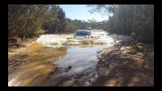 Download Water crossing gone wrong! Triton vs Hilux. Video