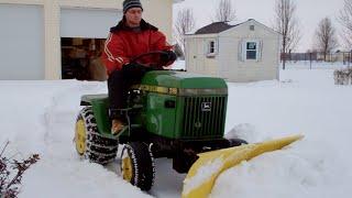 Download John Deere 318 plowing snow Video