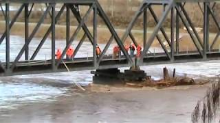 Download BNSF Railroad uses locomotives to clear log jam from bridge Puyallup, WA Video
