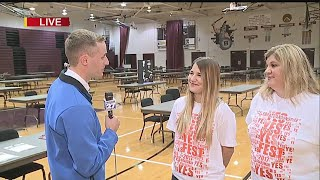 Download Talking with staff members who helped organize the event Video