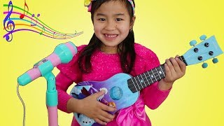 Download Jannie Plays with Disney Frozen Toy Guitar and Starts a Band Video