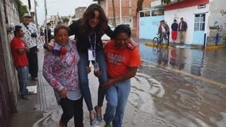 Download TV Reporter Fired After Being Carried Over Floodwaters to Keep Shoes Clean Video