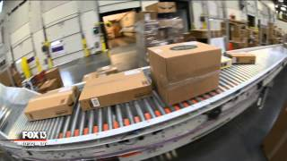 Download Behind the scenes of an Amazon warehouse Video