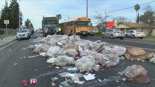 Download Sanitation employee presses wrong button, unloading 20 yards of trash in Fresno Video