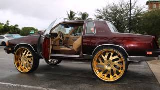 Download WhipAddict: Coast 2 Coast Customs; Cutlass on 30″ All Gold Amani Forged, 72' Donk, 16' Denali Video