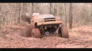 Download huge mud trucks with big blocks in deep ruts Video